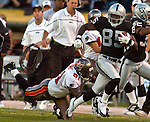 Oakland Raiders wide receiver Doug Gabriel (85) gets away from Tampa Bay Buccaneers linebacker Keith Burns (51) on Sunday, September 26, 2004, in Oakland, California. The Raiders defeated the Buccaneers 30-20.