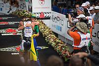 Frederik Van Lierde and Luke McKenzie enjoy their finish at the 2013 Ironman World Championship in Kailua-Kona, Hawaii on October 12, 2013.