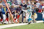 Buffalo Bills wide receiver Eric Moulds (80) shakes off a tackle from safety Marlon McCree (27) to find additional yardage against the Carolina Panthers on November 27, 2005 at Ralph Wilson Stadium in Orchard Park, NY. The Panthers defeated the Bills 13-9. Mandatory Photo Credit: Ed Wolfstein