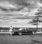 1977.  Acadia National Park, Maine.  Woman leaning on car in top and shorts. 1974 Dodge Dart Sedan