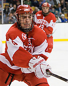 Adam Clendening (BU - 4) - The Boston College Eagles defeated the Boston University Terriers 3-2 (OT) in their Beanpot opener on Monday, February 7, 2011, at TD Garden in Boston, Massachusetts.