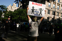 """A Occupy wall street member takes part during a silent march to end the """"stop-and-frisk"""" program in New York June 17, 2012.  Photo by Kena Betancur / VIEWpress.."""