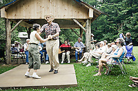 People listening to mountain music and watching traditional folk dances at Mabry Mill Virginia