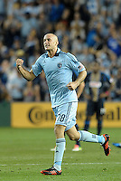 Sporting KC defender Aurelien Collin celebrates the team's go ahead goal late inn the game..Sporting Kansas City defeated Philadelphia Union 2-1 at LIVESTRONG Sporting Park, Kansas City, KS.