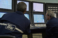 Ryazan, Russia, 03/11/2004..The TNK-BP Ryazan oil refinery..Comtrollers using new computers installed in new Catylisation Cracker control room.