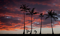 A photographer and his model on a breezy day at sunset, O'ahu.