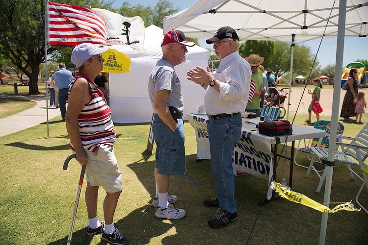 UNITED STATES - MAY 26:  Dick and Patty Jones talk with Ron Barber, right, democratic contender in the AZ-08 special election, during the Rita Ranch Family Fun Day in Tucson, Ariz.  The winner of the election on June 12th will fill the seat occupied by former Rep. Gabrielle Giffords, D-Ariz.  (Photo By Tom Williams/CQ Roll Call)