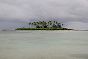 One of the islands of the Kiribati atoll in the Pacific Ocean. The islands, and their way of life, are endangered by rising sea water levels which are eroding the fragile atoll, home to approximately 92,000 people.