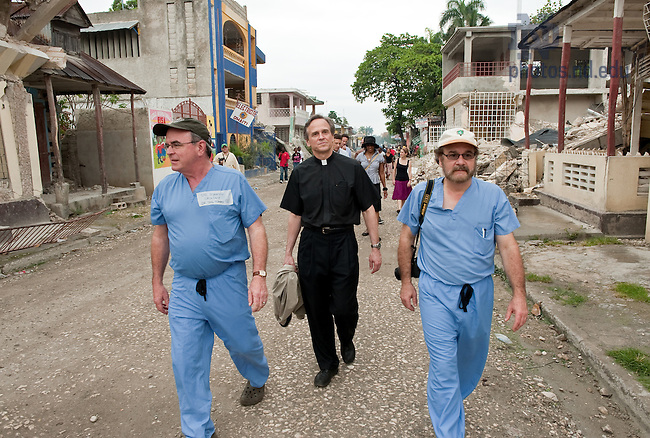 Fr. Jenkins walks through Leogane, Haiti with Dr. Marty Dineen, left, and Dr. Ralph Pennino March 5, 2010.  Fr. Jenkins led a University delegation to Haiti to visit the Notre Dame Haiti program as well as Congregation of Holy Cross schools and facilities in the wake of the Jan. 12, 2010 Haiti Earthquake..Photo by Matt Cashore/University of Notre Dame