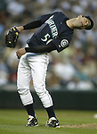 Seattle Mariners' Jamie Moyer uses a little body english to help right fielder Ichiro Suzuki catch Colorado Rockies'  Ryan Spilborgh's pop fly in the ninth inning in Seattle on June 30, 2006. Jim Bryant Photo. ©2010. ALL RIGHTS RESERVED.
