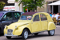 Classic Deux Chevaux 2CV car in Place du Marche town square, Richelieu, Loire Valley, Indre et Loire, France