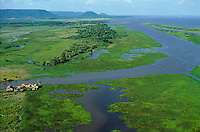 Aerial view of lower Amazon floodplain at low water level during dry season showing uncovered grasslands and a group of farms.