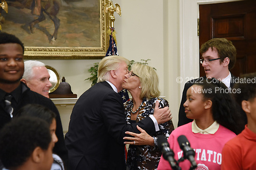 United States President Donald J. Trump greets US Secretary of Education Betsy DeVos during a School Choice event  in the Roosevelt Room of the White House in Washington, DC, on May 3, 2017. <br /> Credit: Olivier Douliery / Pool via CNP