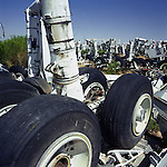 In mid-day heat of the arid Arizona desert, a complete set of main landing gear undercarriage stands upright amid a field of similar items from airliners at the storage facility at Davis Monthan, Tucson. Here, the fate of the world?s retired civil airliners is decided by age or cooling economy. Cannibalised for still-working parts or recycled for scrap, their aluminium is worth more than their sum total. Elsewhere, assorted aircraft wrecks sit abandoned in the scrub minus their bellies, legs or wings like dying birds. After a lifetime of safe commercial flight, wings are clipped and cockpits sliced apart by huge guillotines, cutting through their engineering. Picture from the 'Plane Pictures' project, a celebration of aviation aesthetics and flying culture, 100 years after the Wright brothers first 12 seconds/120 feet powered flight at Kitty Hawk,1903.