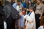 Tufts Schweitzer fellow students help teach local kids about dental hygiene at Chinatown's annual Oak Street Fair organized by Boston Chinatown Neighborhood Center at Josiah Quincy Elementary School.  (Zara Tzanev for Tufts University)