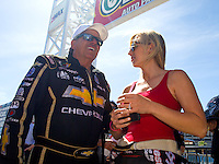 Apr 12, 2015; Las Vegas, NV, USA; NHRA funny car driver Courtney Force (right) talks with her father John Force during the Summitracing.com Nationals at The Strip at Las Vegas Motor Speedway. Mandatory Credit: Mark J. Rebilas-
