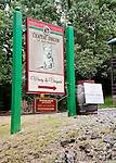 The sign for Chateau O'Brien Winery and Vineyard stands at the bottom of the drive, near the Markham post office and railroad crossing.