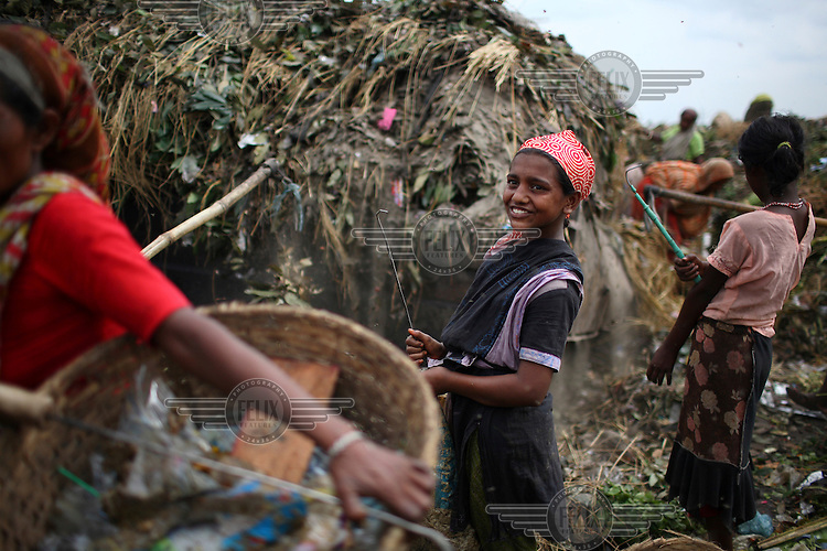 Girls collecting rubbish for resale. At the end of each day, they earn TK 55 to 70 (USD 1). The Matuail Dump is one of three waste sites in Dhaka, a city of over ten million people. On average, 5,000 tonnes of waste are dumped at Matuail every day. At least 1,000 people and 150 children are engaged in garbage picking. .....
