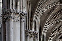 Detail of the nave, with columns topped by carved Corinthian capitals and the rib vaults of the ceiling, in the Cathedrale Notre-Dame de Reims or Reims Cathedral, Reims, Champagne-Ardenne, France. The cathedral was built 1211-75 in French Gothic style with work continuing into the 14th century, and was listed as a UNESCO World Heritage Site in 1991. Picture by Manuel Cohen