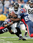 26 November 2006: Jacksonville Jaguars quarterback David Garrard (9) scrambles for yardage against the Buffalo Bills before Buffalo linebackers Angelo Crowell (55) and London Fletcher (59) make the takedown at Ralph Wilson Stadium in Orchard Park, NY. The Bills defeated the Jaguars 27-24. Mandatory Photo Credit: Ed Wolfstein Photo<br />