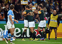JP Pietersen of South Africa is congratulated on his try. Rugby World Cup Bronze Final between South Africa and Argentina on October 30, 2015 at The Stadium, Queen Elizabeth Olympic Park in London, England. Photo by: Patrick Khachfe / Onside Images