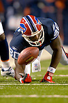 17 December 2005: Buffalo Bills wide receiver Eric Moulds hits the turf after receiving a pass against Denver Broncos at Ralph Wilson Stadium in Orchard Park, NY. The Broncos defeated the Bills 28-17. .Mandatory Photo Credit: Ed Wolfstein