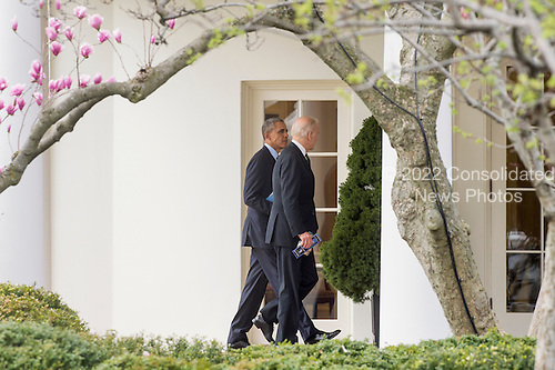 US President Barack Obama (L) and US Vice President Joe Biden (R) walk outside the Oval Office upon returning to the White House following the Friends of Ireland Luncheon on Capitol Hill, in Washington, DC, USA, 15 March 2016.<br /> Credit: Michael Reynolds / Pool via CNP