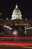 Traffic crossing Pennsylvania avenue creates light streaks with the Capitol dome in the background in Washington DC