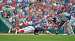 3 September 2012: Washington Nationals rookie outfielder Bryce Harper dives safely back to first as first baseman Anthony Rizzo attempts a pickoff during a game against the Chicago Cubs at Nationals Park in Washington, DC. The Nationals edged out the visiting Cubs 2-1, in the first game of heir 4-game series. Mandatory Credit: Ed Wolfstein Photo