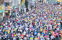 Thousands of runners fill the streets of Tokyo in its 2013 Marathon.