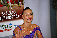 """Joanna Mitrosz of Poland smiles to camera at """"kiss & cry"""" during event finals at 2010 Holon Grand Prix at Holon, Israel on September 4, 2010.  (Photo by Tom Theobald)."""