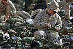 A few days before they begin the journey back to the United States after eight months in Najaf, Iraq, Marines with Charlie Co. 1st Battalion 4th Marines sort and pack their gear for the trip to Kuwait on January 28, 2005.