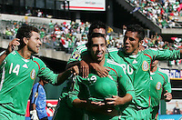 Luis Miguel Noriega (19) celebrates his goal with Miguel Sabah (14) and Israel Martinez (20). Mexico defeated Nicaragua 2-0 during the First Round of the 2009 CONCACAF Gold Cup at the Oakland, Coliseum in Oakland, California on July 5, 2009.