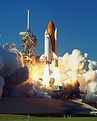 Clouds of exhaust and blazing light fill Launch Pad 39B as Space Shuttle Discovery lifts off at 2:19 p.m. EST October 29, 1998 on mission STS-95. Making his second voyage into space after 36 years is Payload Specialist John H. Glenn Jr., senator from Ohio. Other crew members are Mission Commander Curtis L. Brown Jr., Pilot Steven W. Lindsey, Payload Specialist Chiaki Mukai, (M.D., Ph.D.), with the National Space Development Agency of Japan (NASDA), Mission Specialist Stephen K. Robinson, Mission Specialist Pedro Duque of Spain, representing the European Space Agency (ESA), and Mission Specialist Scott E. Parazynski. The STS-95 mission includes research payloads such as the Spartan solar-observing deployable spacecraft, the Hubble Space Telescope Orbital Systems Test Platform, the International Extreme Ultraviolet Hitchhiker, as well as the SPACEHAB single module with experiments on space flight and the aging process. Discovery is expected to return to KSC at 11:49 a.m. EST on Nov. 7, 1998..Credit: NASA via CNP