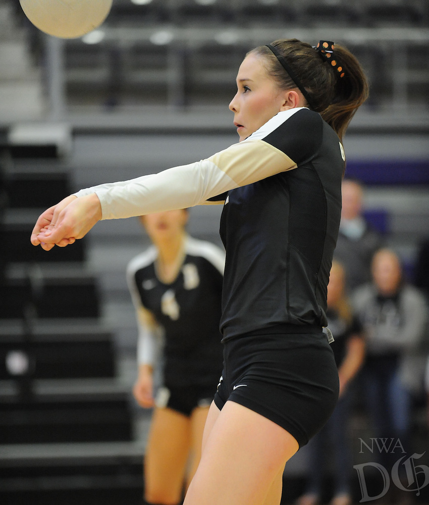 STAFF PHOTO ANDY SHUPE - Anna Leduc of Bentonville digs a ball against Conway Thursday, Oct. 30, 2014, during play in the semi-final round of the Class 7A state tournament at Fayetteville High School.