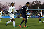 12 December 2014: Virginia's Darius Madison (9) and UMBC's Spencer Williams (16). The University of Virginia Cavaliers played the University of Maryland Baltimore County Retrievers at WakeMed Stadium in Cary, North Carolina in a 2014 NCAA Division I Men's College Cup semifinal match.