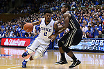 30 November 2014: Duke's Quinn Cook (left) and Army's Mo Williams (right). The Duke University Blue Devils hosted the West Point Military Academy Army Black Knights at Cameron Indoor Stadium in Durham, North Carolina in a 2014-16 NCAA Men's Basketball Division I game. Duke won the game 93-73.