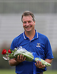 Duke head coach Robbie Upchurch waits with roses as the team honored nine players on Senior Day on Sunday, October 22nd, 2006 at Koskinen Stadium in Durham, North Carolina. The Duke Blue Devils defeated the Florida State University Seminoles 3-1 in an Atlantic Coast Conference NCAA Division I Women's Soccer game.