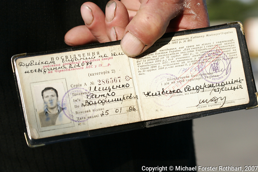 Petro Meshchenko shows me his liquidator certificate. It reads, &ldquo;The bearer of this identification has a right to receive benefits and compensations stipulated by the law of Ukraine, &lsquo;On the status and social protections of citizens who suffered as a result of the Chernobyl catastrophe,&rsquo; for participants in the liquidation &hellip; who worked in the zone in May and June of 1986, regardless of the number of the days worked, or from July 1 to December 31, 1986, for no less than five days, or in 1987 for no less than 14 working days.&rdquo;<br /> ------------------- <br /> This photograph is part the book of Would You Stay?, by Michael Forster Rothbart, published by TED Books in 2013. The photos come from Forster Rothbart&rsquo;s two long-term documentary photography projects, After Chernobyl and After Fukushima.<br /> &copy; Michael Forster Rothbart 2007-2013.<br /> www.afterchernobyl.com<br /> www.mfrphoto.com &bull; 607-267-4893 &bull; 607-436-2856 <br /> 34 Spruce St, Oneonta, NY 13820<br /> 86 Three Mile Pond Rd, Vassalboro, ME 04989<br /> info@mfrphoto.com<br /> Photo by: Michael Forster Rothbart<br /> Date:  5/2007    File#:  Canon 20D digital camera frame 4615