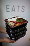 Jessica Salgado, of the Cafe, holds bento boxes of organic vegetarian, pork cutlet, shrimp cake (pictured here), and chicken dumplings by Delica, at New People, a five-story, glass-walled retail complex that holds a cafe, movie theater, five shops and a gallery, in Japantown, in San Francisco, Ca., on Saturday, May 29, 2010.