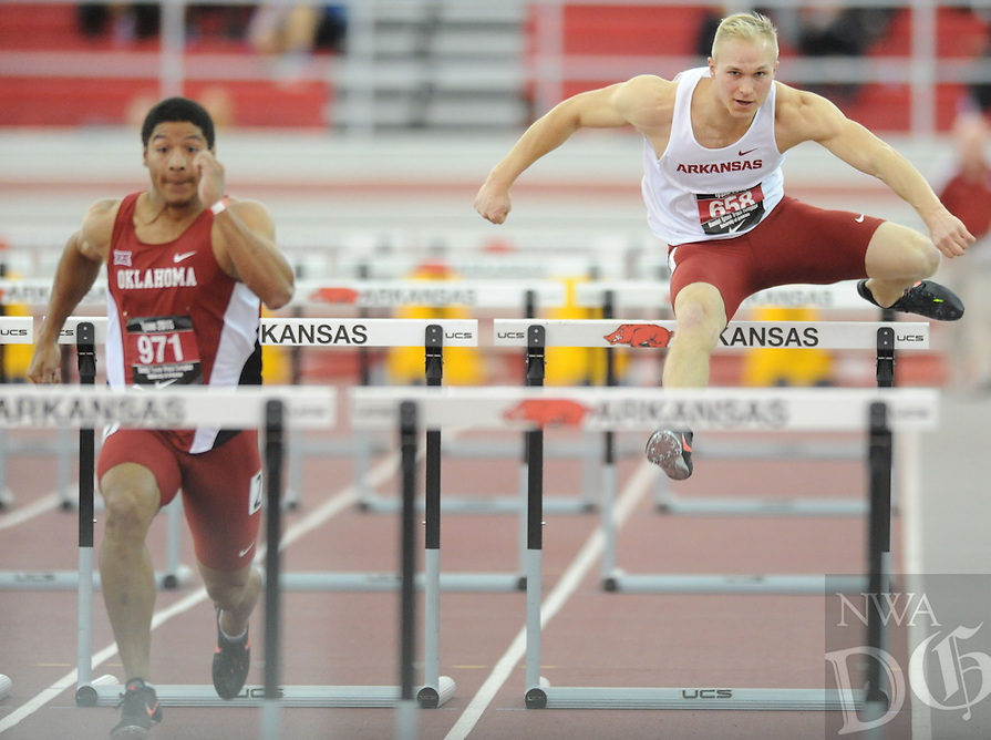 NWA Democrat-Gazette/ANDY SHUPE - Nathaniel Franks (right) of Arkansas trails Thomas Cheval of Oklahoma as he competes in the 60-meter hurdles during the Tyson Invitational Friday, Feb. 13, 2015, at the Randal Tyson Track Center in Fayetteville.