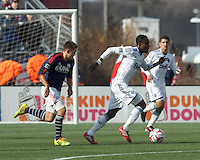 Vancouver Whitecaps FC substitute midfielder Gershon Koffie (28) works to clear ball. In a Major League Soccer (MLS) match, the New England Revolution (blue/white) tied Vancouver Whitecaps FC (white), 0-0, at Gillette Stadium on March 22, 2014.