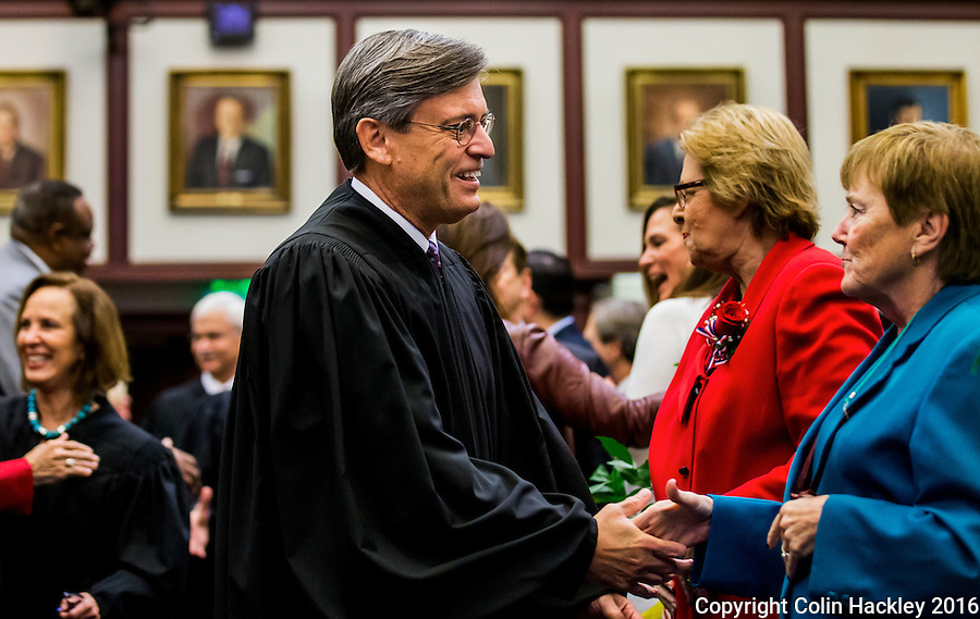 TALLAHASSEE, FLA. 1/12/16-Florida Supreme Court Chief Justice Jorge Labarga, left, greets, Rep. Marlene O'Toole, R-Lady Lake, during the opening day of the 2016 legislative session, Tuesday at the Capitol in Tallahassee.<br /> <br /> COLIN HACKLEY PHOTO