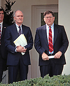 National Security Advisor Brent Scowcroft and White House Chief of Staff John Sununu look on as United States President George H.W. Bush (not pictured) reads a statement rejecting the proposed Soviet peace agreement to end the Gulf War with Iraq in the Rose Garden of the White House in Washington, D.C. on February 22, 1991.<br /> Credit: Howard L. Sachs / CNP