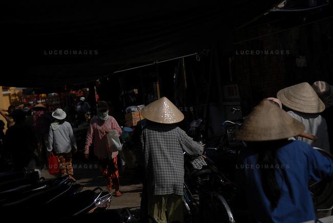 Vietnamese people walk in the streets of Hoi An, Vietnam.