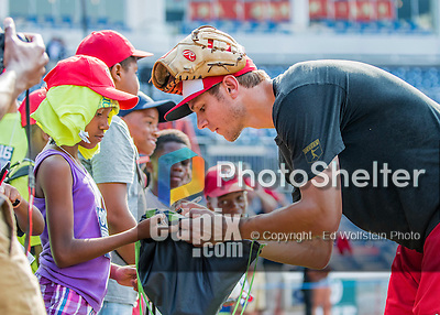22 July 2016: Washington Nationals infielder Trea Turner signs autographs prior to a game against the San Diego Padres at Nationals Park in Washington, DC. The Padres defeated the Nationals 5-3 to take the first game of their 3-game, weekend series. Mandatory Credit: Ed Wolfstein Photo *** RAW (NEF) Image File Available ***