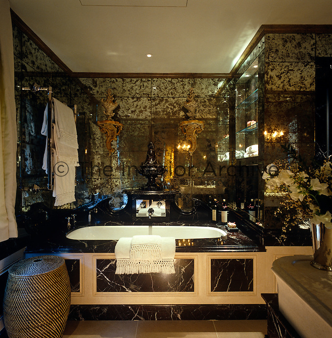 "This black marble bathroom has walls of ""verre eglomise"" for heightened drama"