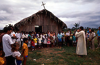 Father Ricardo Rezende. Outdoor mass for squatters and landless workers. Community organizing for land reform at  East Amazon, City: Rio Maria; State: Pará; Brazil.