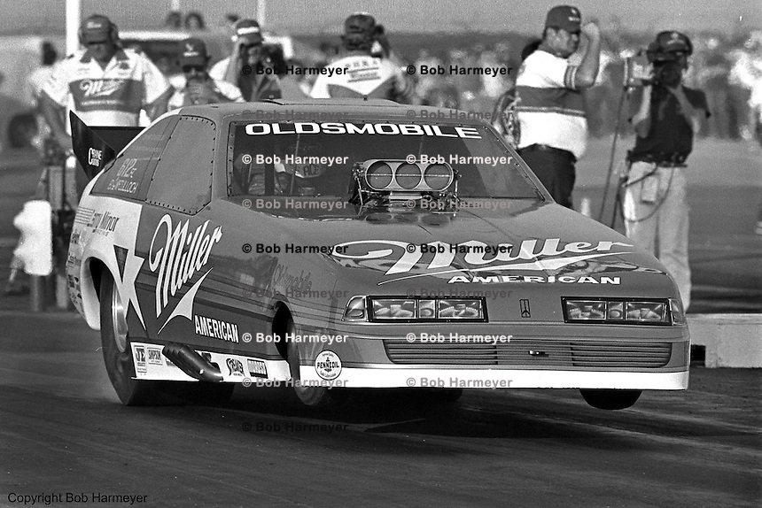"POMONA, CALIFORNIA: Ed ""Ace"" McCulloch drives his Oldsmobile Funny Car during a 1985 NHRA drag race at Pomona, California."