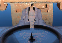 Fountain in the pond in the Court of the Myrtles, or Patio de los Arrayanes, built in the 14th century under Yusuf I, in the Comares Palace, Alhambra Palace, Granada, Andalusia, Southern Spain. The Alhambra was begun in the 11th century as a castle, and in the 13th and 14th centuries served as the royal palace of the Nasrid sultans. The huge complex contains the Alcazaba, Nasrid palaces, gardens and Generalife. Picture by Manuel Cohen